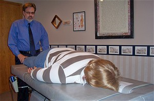 Whole body exam and adjusting from feet to head